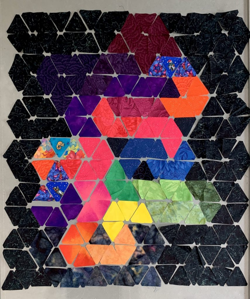 Peer Gynt quilt laid out in separate triangles