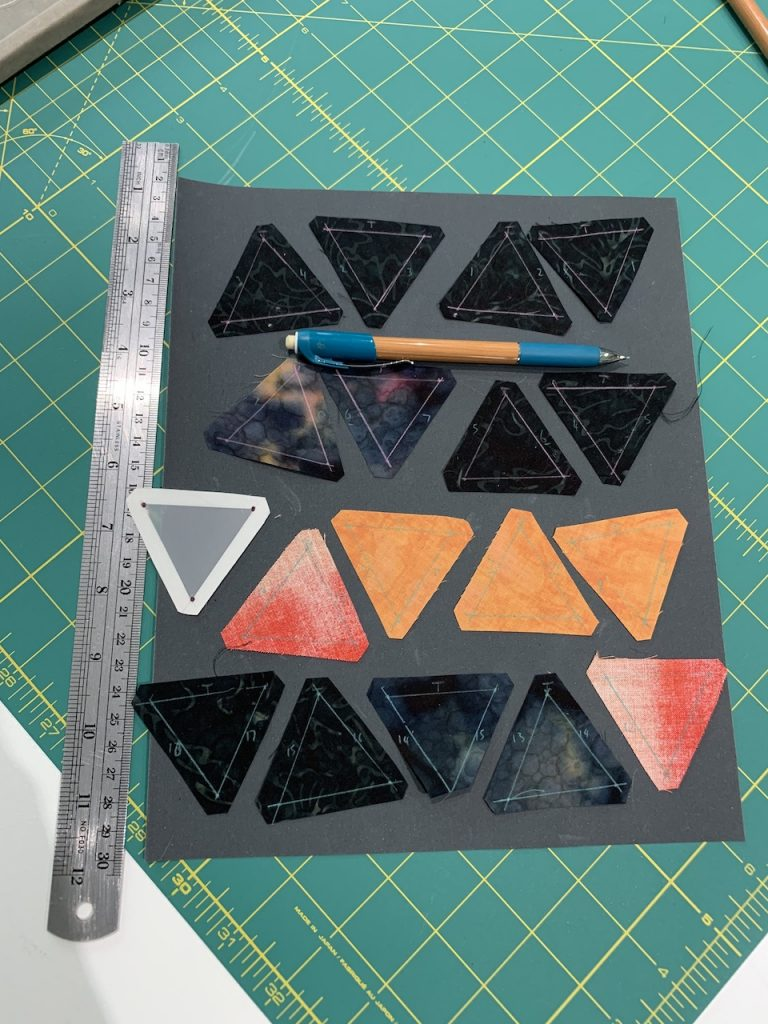 A row of triangles arranged on sandpaper