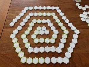 Die-cut hexagons arranged in a spiral, on a wooden table